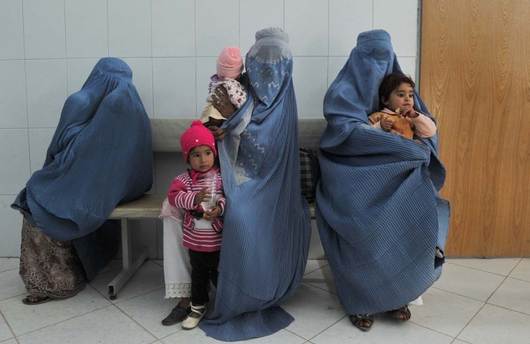 Afghan women wait with their children to receive a polio vaccination on the second day of a vaccination campaign in Herat on October 15, 2012. A new three-day nationwide immunization campaign against polio began all over the country. (Aref Karimi/AFP/Getty Images)