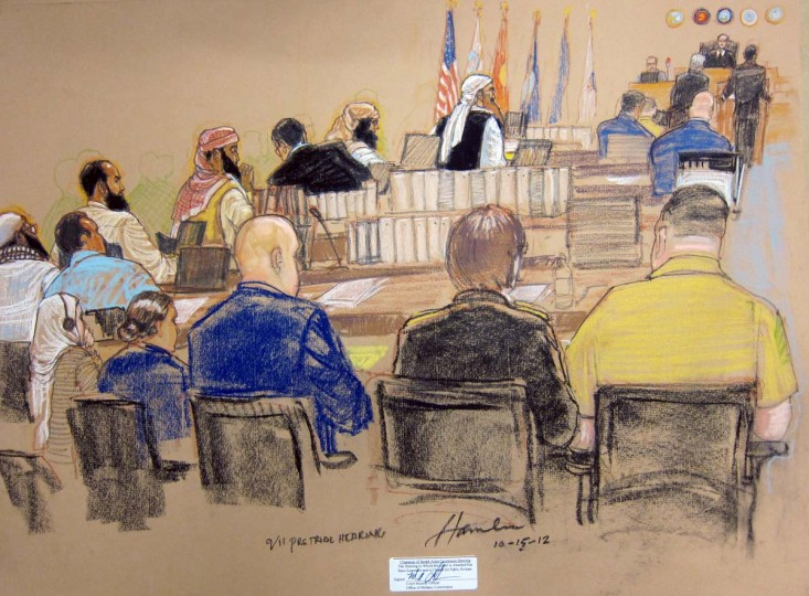 This courtroom sketch by artist Janet Hamlin shows the alleged five men (above) accused of conspiracy in the Sept. 11, 2001 attacks, shown sitting at their Military Commissions hearing on October 15, 2012 at the U.S. Navy base Guantanamo Bay, Cuba. Long-delayed efforts to try Khalid Sheikh Mohammed and four Al-Qaeda co-defendants finally got under way on Monday with a pre-trial hearing at Guantanamo. (Janet Hamlin via AFP/Getty Images)