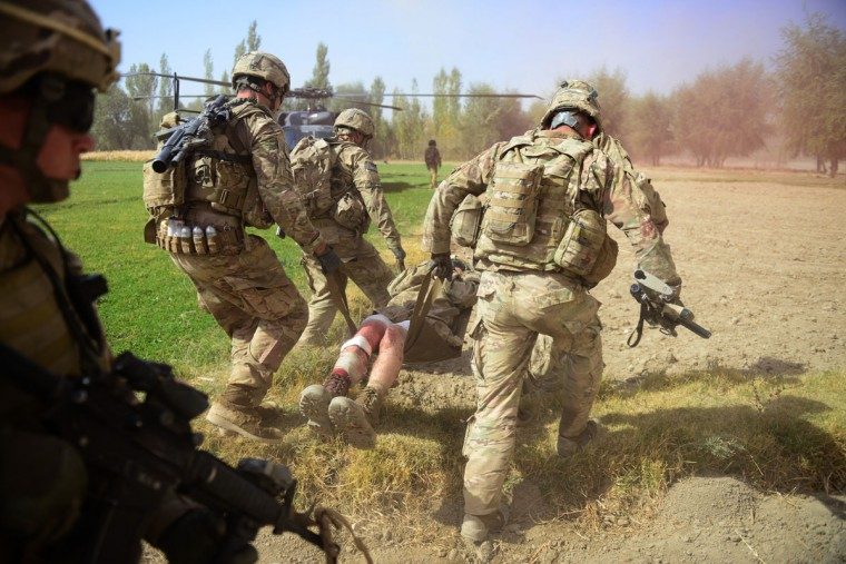 US Army soldiers attached to 2nd platoon, C troop, 1st Squadron (Airborne), 91st U.S Cavalry Regiment, 173rd Airborne Brigade Combat Team operating under NATO sponsored International Security Assistance Force (ISAF) carry a wounded comrade injured in an Improvised Explosive Device (IED) blast during a patrol near Baraki Barak base in Logar Province on October 13, 2012. The soldier, 21 year-old Private Ryan Thomas from Oklahoma suffered soft tissue damage and after surgery in Afghanistan was scheduled to be evacuated to Germany. (Munir uz Zuman/AFP/Getty Images)