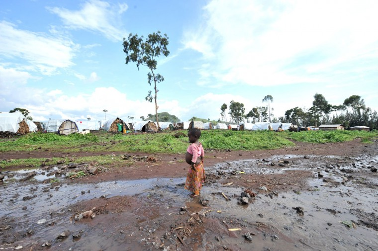 A child stands on October 15, 2012 in the Kanyaruchinya camp for internally displaced people, some 10 kms from the eastern Congolese city of Goma. The camp houses some 57,00 people from the Rutshuru territory, which borders Rwanda and Uganda. The M23 movement -- a group of former Tutsi rebels who had been integrated in the regular army in 2009 -- has been battling Democratic Republic of Congo troops since May in Rutshuru. (Junior D. Kannah/AFP/Getty Images)