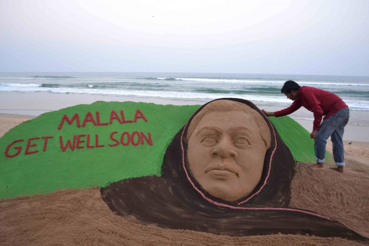 Indian sand artist Sudarsan Pattnaik gives final touches on a sand sculpture in honour of Pakistani girl Malala Yousufzai at Puri beach, some 65 kilometers from Bhubaneswar. In an attack which outraged the world, Malala was shot on a school bus in the former Taliban stronghold of the Swat valley October 9 as a punishment for campaigning for the right to an education. (STR/DEL/AFP/Getty Images)