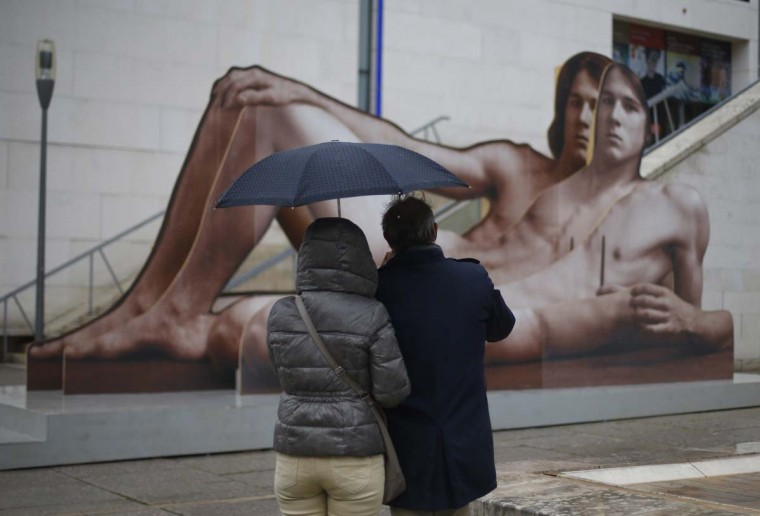 Tourists take a picture of an artwork entitled 'Mr Big' by Austrian artist Ilse Haider, displayed outside of the Leopold Museum in Vienna, for a forthcoming an art exhibition on nude men, entitled 'Nackte Manner' (Naked Men), on October 16, 2012. (Alexander Klein/AFP/Getty Images)