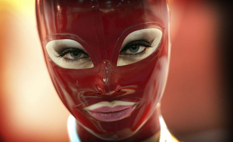 A woman wears a mask at the Venus international fair for Erotic Entertainment and Lifestyle in Berlin. The fair, one of the largest of its kind, runs until Ocober 21, 2012. (Johannes Eisele/Getty Images)
