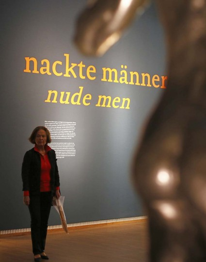 A woman looks at sculptures and artwork as part of the 'Nackte Maenner' (Nude men) exhibition at the Leopold Museum in Vienna, on October 18, 2012. (Alexander Klein/AFP/Getty Images)