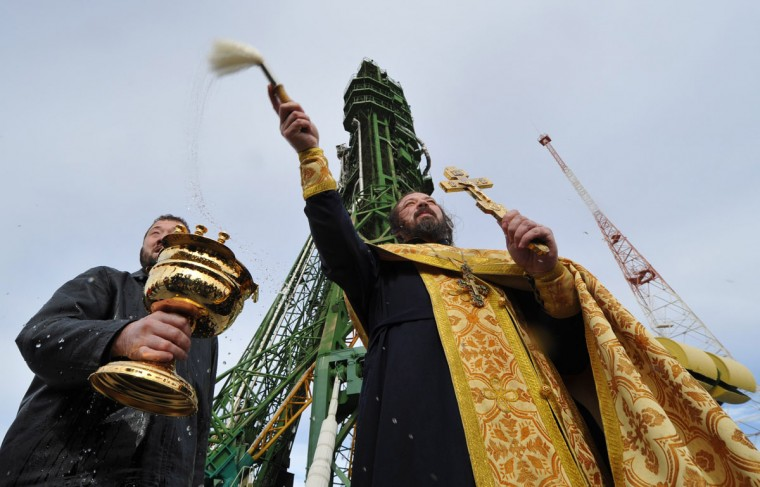 October 22, 2012: A Russian Orthodox priest blesses the Soyuz TMA-06M spacecraft of the next expedition to the International Space Station (ISS) at the launch pad of the Russian leased Kazakhstan's Baikonur cosmodrome. (Vyacheslav Oseledko/AFP/Getty Images)