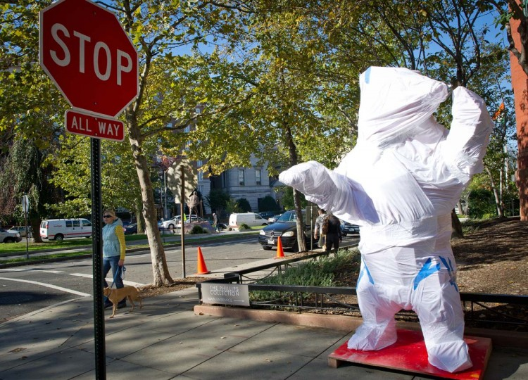 "The wrapped for transportation sculpture called ""The Bear"" created by the French artist Xavier Veilhan is seen outside The Phillips Collection Gallery in Washington DC, October 22, 2012. The 8 foot (2m 45cm) sculpture will be displayed outside the gallery as a part of an exhibition featuring 18 recent works by Veilhan. (Mladen Antonov/AFP/Getty Images)"
