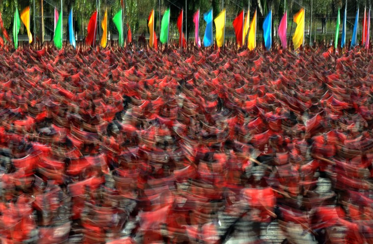 This picture taken on October 22, 2012 shows kungfu students performing on the way to the Shaolin Temple to welcome guests at the 9th Zhengzhou International Shaolin Wushu Festival in Zhengzhou, central China's Henan Province. (AFP/Getty Images)