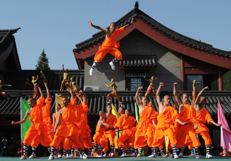 This picture taken on October 22, 2012 shows kungfu students performing at a Shaolin Temple to welcome guests during the 9th Zhengzhou International Shaolin Wushu Festival in Zhengzhou, central China's Henan Province. (AFP/Getty Images)
