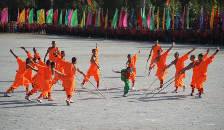This picture taken on October 22, 2012 shows kungfu students performing at a Shaolin Temple to welcome guests during the 9th Zhengzhou International Shaolin Wushu Festival in Zhengzhou, central China's Henan Province. More than 1500 athletes from 73 countries and regions took part in the 5-day festival. (AFP/Getty Images)