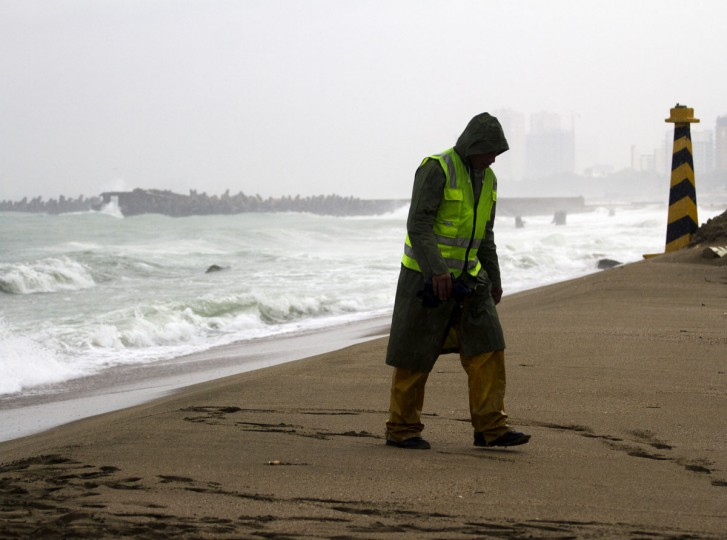 October 24, 2012: A local resident walks under the rain at the Sans Souci seafront, east coast of Santo Domingo. (Erika Santelices/AFP/Getty Images)