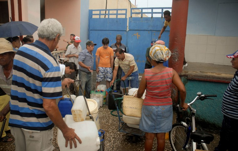 October 24, 2012: Citizens of Bayamo, 740 km east of Havana, line up to be given water as the residents of eastern Cuba prepare for the arrival of Hurricane Sandy. (STR/AFP/Getty Images)