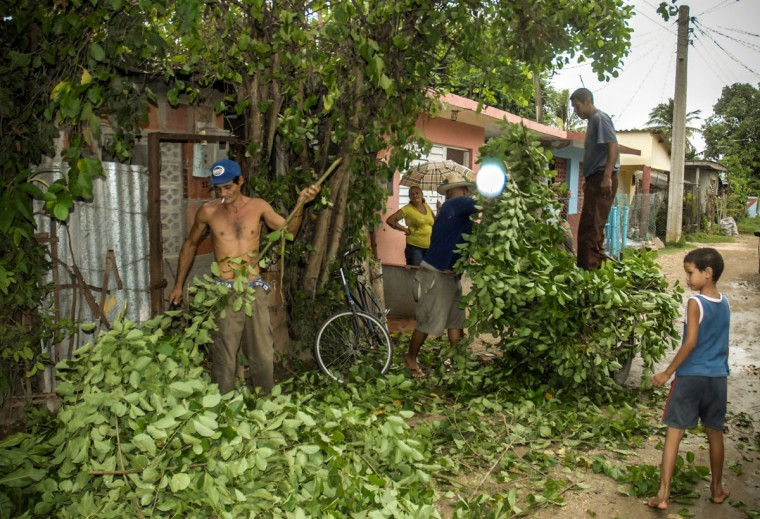 October 24, 2012: Citizens of Bayamo, 740 km east of Havana, prune trees as the residents of eastern Cuba prepare for the arrival of Hurricane Sandy. (STR/AFP/Getty Images)
