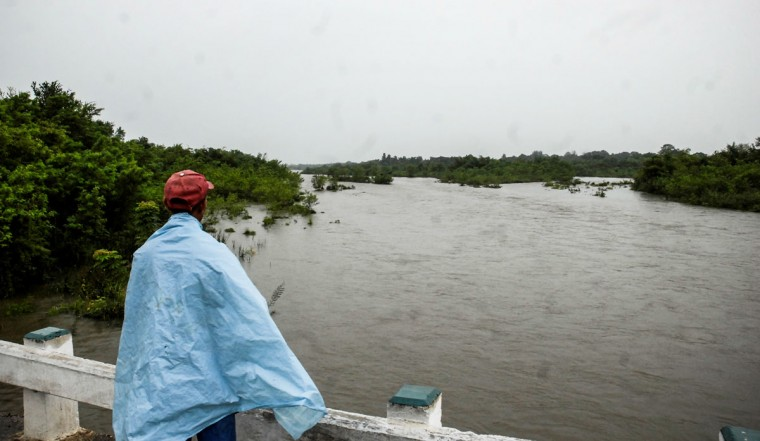 October 24, 2012: A man on a bridge stares at an overflowed river near Bayamo, 740 km east of Havana, as the residents of eastern Cuba prepare for the arrival of Hurricane Sandy. (STR/AFP/Getty Images)