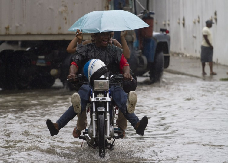 October 24, 2012: Locals ride a motorbike in a flooded street of Santo Domingo before the arrival of Hurricane Sandy on October 24, 2012. (Erika Santelices/AFP/Getty Images)