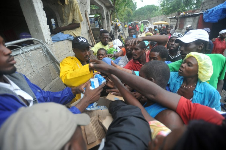 October 25, 2012: The Red Cross distributes supplies to people in the aftermath of Hurricane Sandy in Port-au-Prince, Haiti. (Thony Belizaire/AFP/Getty Images)