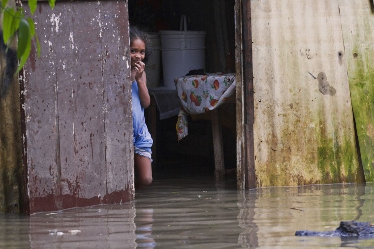 October 25, 2012: A child observes from her flooded house at La Barquita neighborhood, eastern Santo Domingo. (Erika Santelices/AFP/Getty Images)