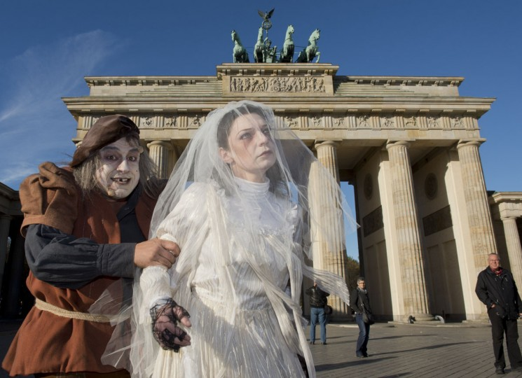 Performers dressed in a medieval costumes and horror-like make-up gesture in front of Brandenburg Gate in Berlin, Germany. The performance was organized as a publicity stunt by Berlin Dungeon, a new scary attraction. (John MacDougall/AFP/Getty Images)