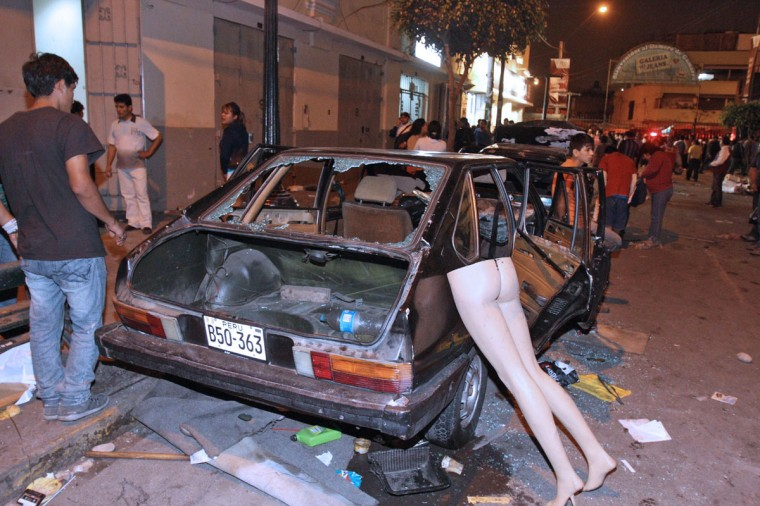 Damage on private property caused during riots at a La Parada market in Lima, on October 25, 2012. Two people were killed and 100 more wounded when clashes erupted Thursday as thousands of police moved in to relocate a crowded wholesale food market in Lima, officials said. The fighting began when the Lima municipality placed concrete blocks at the entrance to the La Parada market to prevent trucks from entering, leading traders to hurl stones in protest and police to respond with tear gas. (GAMARRA/AFP/Getty Images)