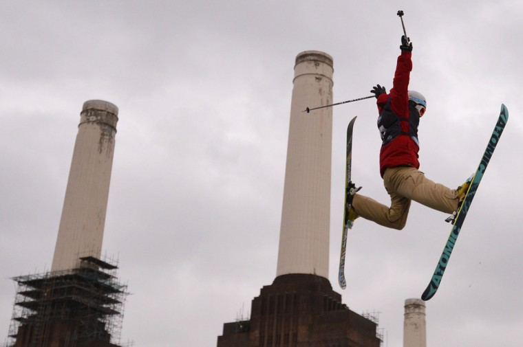 A freestyle skier flies through the air in front of Battersea Power Station during the Relentless Freeze winter sports freestyle skiing competition in London. (Carl Court/AFP/Getty Images)