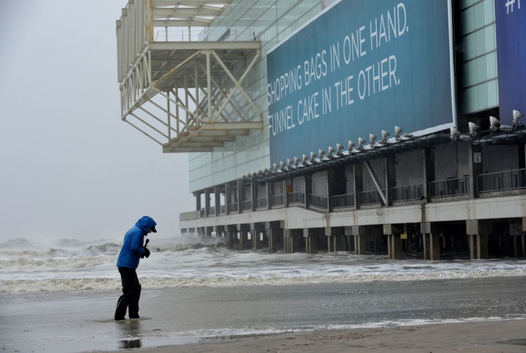 October 29, 2012: A television reporter stands in water on the beach near the Boardwalk before the arrival of Hurricane Sandy in Atlantic City, New Jersey. (Stan Honda/AFP/Getty Images