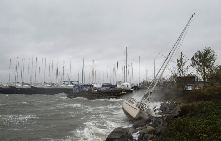 October 29, 2012: A sailboat smashes on the rocks after breaking free from its mooring on City Island in New York. (Don Emmert/AFP/Getty Images)