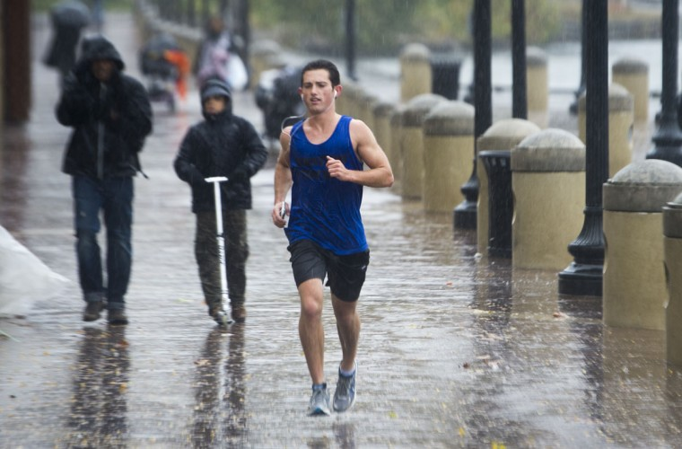 October 29, 2012: A jogger runs in the rain as Hurricane Sandy rains on the Washington Harbor area located on the Potomac River in the Georgetown area of Washington. (Paul J. Richards/AFP/Getty Images)