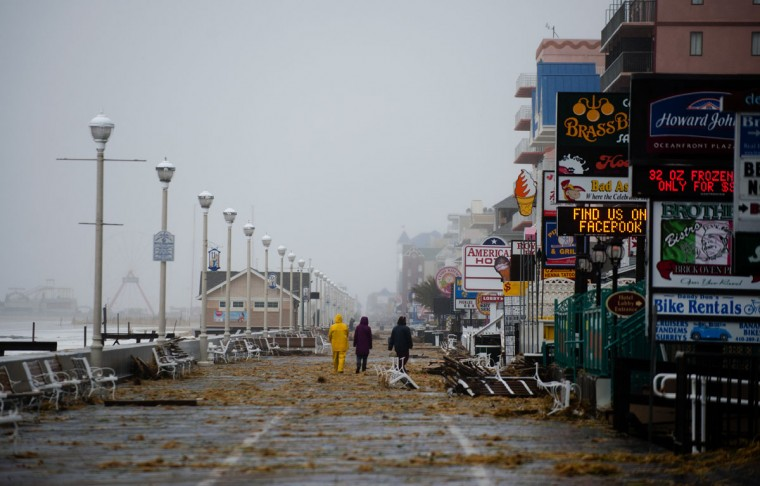 October 29, 2012: People walk on the boardwalk in Ocean City, Maryland as Hurricane Sandy nears landfall in the area. (Jim Watson/AFP/Getty Images)