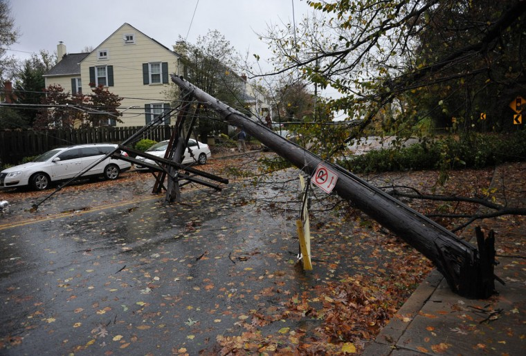 October 30, 2012: A downed ppower line, knocked over by a falling tree, is seen in the wake of Hurricane Sandy in Chevy Chase, Maryland. (Mandel Ngan/AFP/Getty Images)