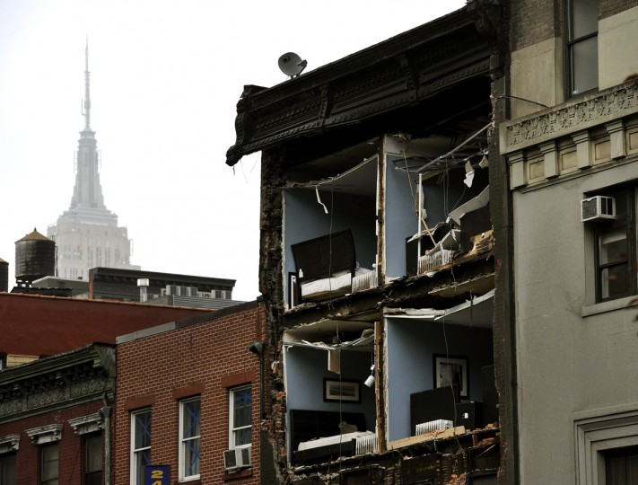 October 30, 2012: The Empire State Building towers in the background of an apartment buliding in Chelsea, New York City, with the facade broken off the morning after Hurricane Sandy. (Timothy A. Clary/AFP/Getty Images)