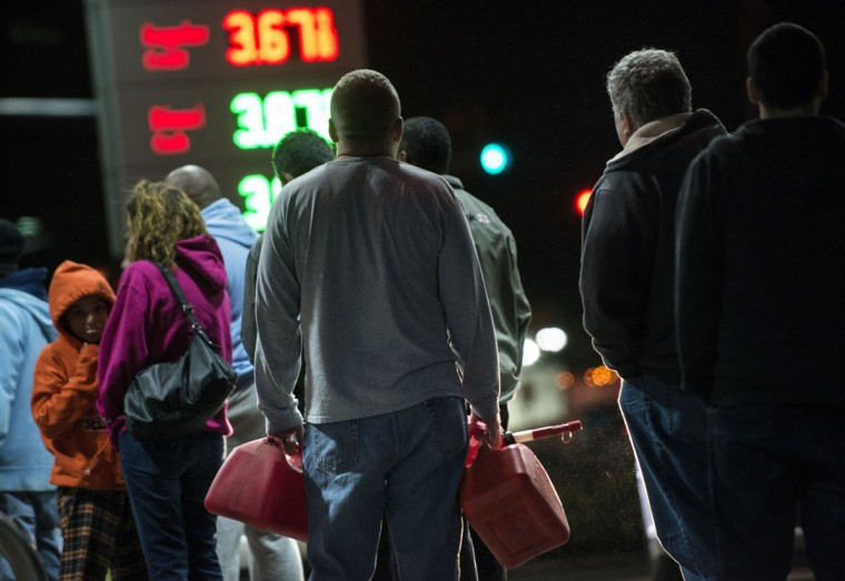 People wait in line to fill containers with fuel at a Shell gas station in Edison, New Jersey. Hurricane Sandy, which hit New York and New Jersey particularly hard, left much of the Edison area flooded and without power. (Brendan Smialowski/AFP/Getty Images)