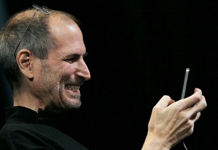 June 7, 2010: Apple CEO Steve Jobs demonstrates the new iPhone 4 as he delivers the opening keynote address at the 2010 Apple World Wide Developers conference in San Francisco, California. Steve Jobs announced on January 17, 2011 that the Apple board has granted him a medical leave of absence. (Justin Sullivan/Getty Images)