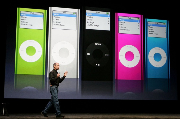 September 12, 2006: Apple CEO Steve Jobs delivers a keynote address in front of an image of the new iPod Nano during an Apple media event in San Francisco, California. Jobs announced new iPods and video downloads from iTunes as well as a sneak peek at a device tentatively called iTV which allows you to channel iTunes to your television and is expected out in early 2007. (Justin Sullivan/Getty Images)