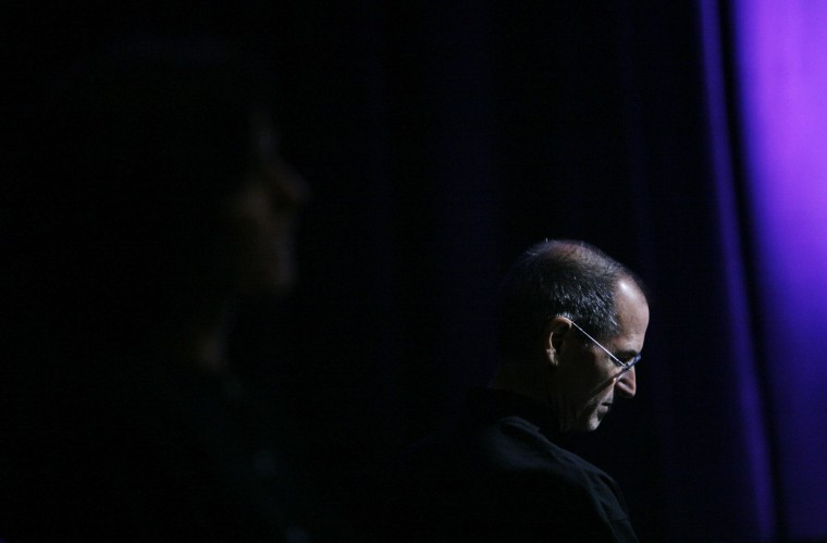 June 9, 2008: Steve Jobs, chief executive officer of Apple Inc., listens to several of the company's application partners speak after announcing the new iPhone 3G and 2.0 software update during the Worldwide Developers Conference in San Francisco, California. (Ryan Anson/AFP/Getty Images)