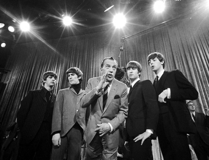 "Ed Sullivan, center, stands with The Beatles during a rehearsal for the British group's first American appearance, on the ""Ed Sullivan Show,"" in New York on Feb. 9, 1964. From left: Ringo Starr, George Harrison, Sullivan, John Lennon and Paul McCartney. The rock 'n' roll band known as 70 million viewers saw ""The Fab Four"". ""Beatlemania"" swept the charts with twenty No.1 hits and more than 100 million records sold. The Beatles broke up in 1970, and John Lennon was shot to death in front of his New York apartment building on Dec. 8, 1980. (AP Photo)"