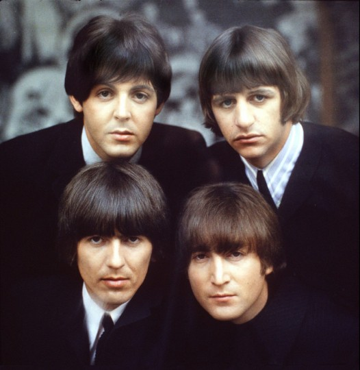 The Beatles, clockwise from top left, Paul McCartney, Ringo Starr, John Lennon, and George Harrison are shown on an album cover in 1965. (Robert Freeman/copyright Apple Corps Ltd.)