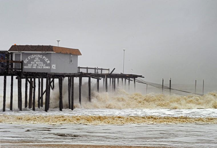 Waiting for landfall: Waves batter the pilings of what still stands of the Ocean City Fishing Pier. (Karl Merton Ferron / Baltimore Sun)