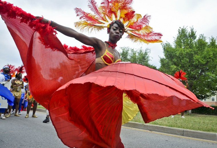 July 16: Colors of the Caribbean. A dancer performs Fantasy Revelers of the Nile, which is presented by Fiyah Bird Producations, at the 2012 Caribbean Parade in Baltimore, Md. (Gabriella Demczuk/Baltimore Sun)