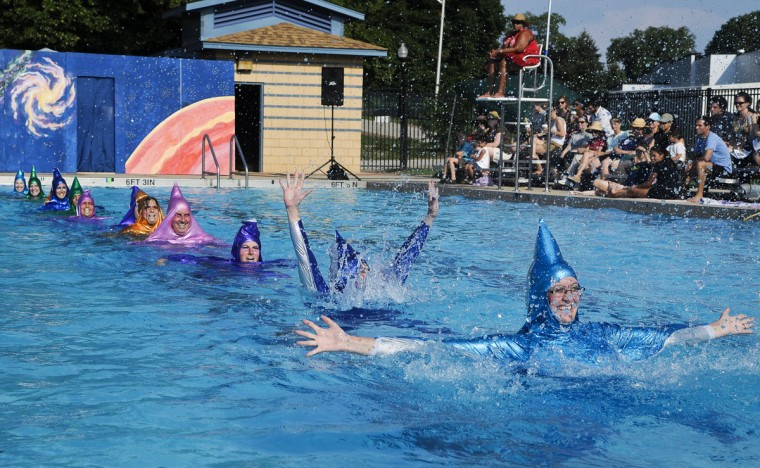 "Aug. 6: Making a splash. Swimmers dressed as stars perform in the first act ""Baby, You're a Star."" Baltimore Fluid Movement puts on ""Rebel Teen from Starship 12,"" an extraterrestrial water ballet show at Patterson Park pool. (Gabriella Demczuk/Baltimore Sun)"