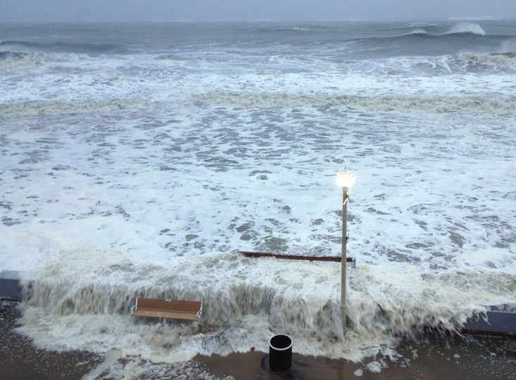 October 29, 2012: Waves from the Atlantic Ocean breach the storm wall at the Ocean City boardwalk at 15th St. even as Hurricane Sandy is still well offshore. (Karl Mertron Ferron/Baltimore Sun)
