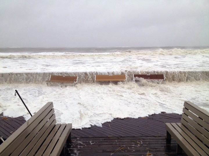 October 29, 2012: Waves from the Atlantic Ocean breach the storm wall at the Ocean City boardwalk at 15th St. even as Hurricane Sandy is still well offshore. Two tourists watch as a wave breaches the seawall while a city truck in background drives along the Ocean City boardwalk as hurricane Sandy begins her track inland. (Karl Mertron Ferron/Baltimore Sun)