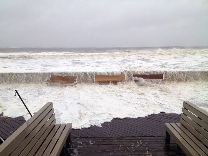 Waiting for landfall: Waves from the Atlantic Ocean breach the storm wall at the Ocean City boardwalk. (Karl Mertron Ferron / Baltimore Sun)