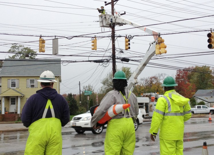 October 30, 2012: BGE crews work to restore power at Ft. Smallwood Rd. 8000 blk, at Hilltop Rd. Orchard Beach neighborhood. (Amy Davis/Baltimore Sun)