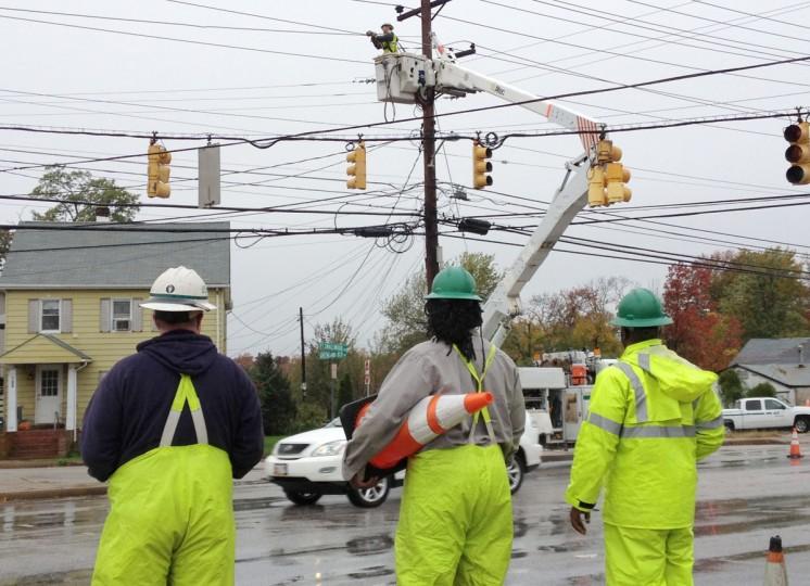 October 30, 2012: BGE crews work to restore power at Ft. Smallwood Rd. 8000 blk, at Hilltop Rd. Orchard Beach neighborhood. (Amy Davis/Baltimore Sun)
