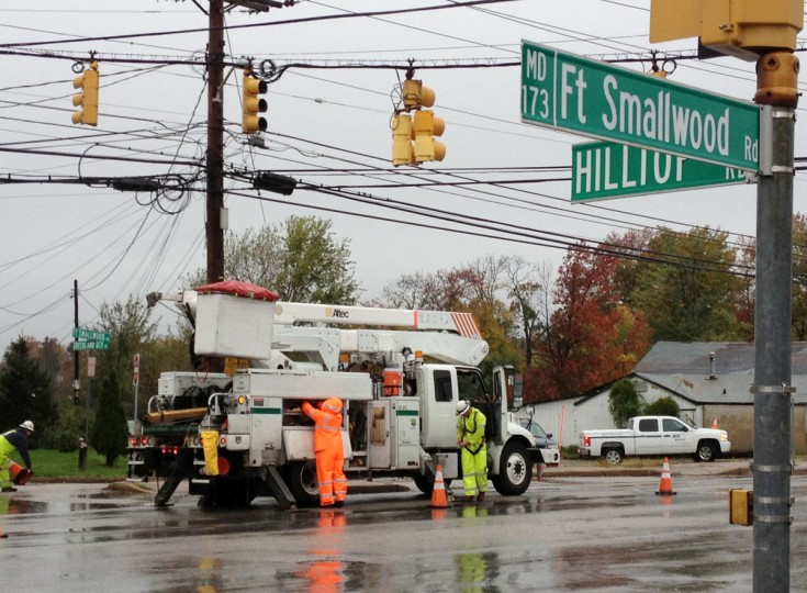 October 30, 2012: BGE crews work to restore power at Ft. Smallwood Rd at Hilltop Rd., Anne Arundel County. (Amy Davis/Baltimore Sun)