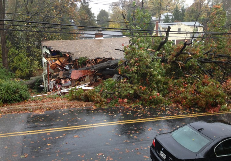 October 29, 2012: 420 W. Maple Rd., Linthicum, Maryland after a tree fell onto it because of Hurricane Sandy's high winds. (Amy Davis / Baltimore Sun)