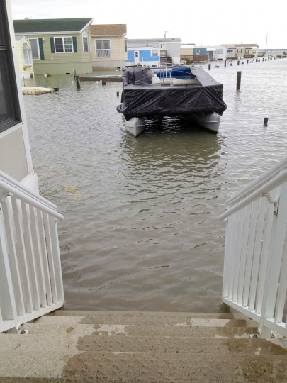 The steps of one mobile home leads to water and a pontoon boat at Launch Drive Lane. (Karl Merton Ferron / Baltimore Sun)