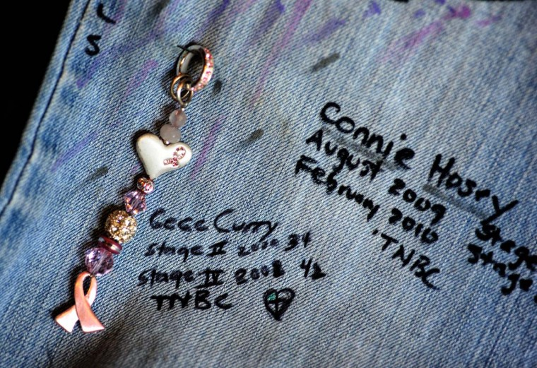 """Cecilia """"CC"""" Curry who signed the pants, is a member of METAvivor Research and Support (www.METAvivor.org) whose mission is to raises awareness and award annual research grants for stage IV breast cancer. The organization has raised at least $400,000 since 2009 for Stage IV cancer research. (Algerina Perna/Baltimore Sun Photo)"""