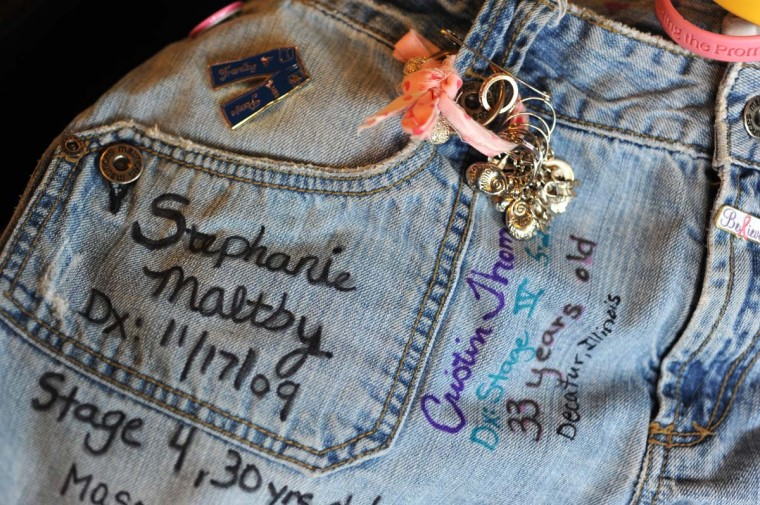 "Stephanie Maltby's name is embroidered on the right pants pocket. In a 2011 interview, Stephanie Maltby said that her sister, Shannon Kegebein, who created the idea, ""wanted me to see other people in my shoes."" (MLive by Brad Flory 5/7/11). Algerina Perna Baltimore Sun Photographer dr-traveling-pants-p2-perna-#6359"