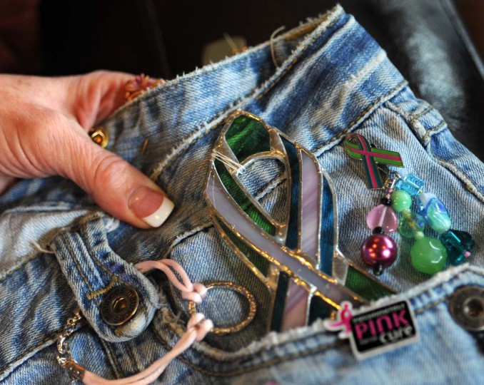 Corneliussen-James holds the Stage 4 Traveling pants which have traveled in the US, Canada, Europe, Chile and New Zealand since 2009. The ribbon pin is the metastatic Breast Cancer Awareness ribbon pin. It was designed by METAvivor in 2008. Thousands have been distributed over the past four years. (Algerina Perna/Baltimore Sun Photo)