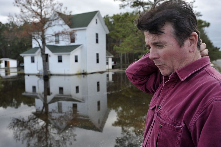 Gary Catlin, Fairmont, talks about the damage his property sustained from tidewater that was pushed into his community by Superstorm Sandy. (Kim Hairston/Baltimore Sun)